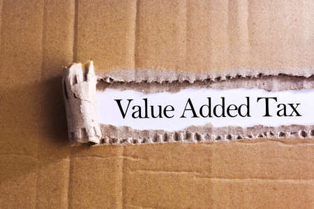Torn paper box with word Value added tax