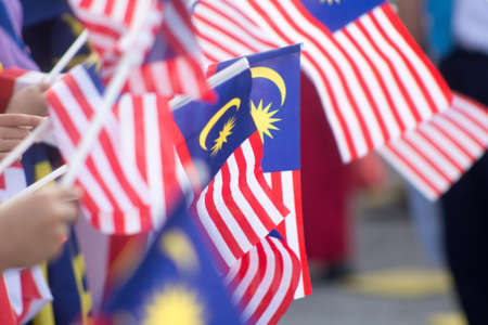 Photo pour Hand waving Malaysia flag also known as Jalur Gemilang in conjunction with the Independence Day celebration or Merdeka Day. - image libre de droit