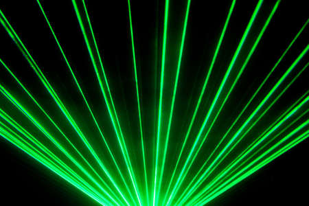 Photo pour Green laser show nightlife club stage and shining sparkling rays. Luxury entertainment in nightclub event, festival, concert or New Years Eve. Ray beams are symbol for science and universe research. - image libre de droit