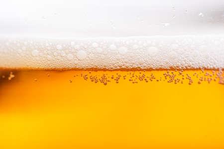 Photo pour Light Beer with Bubbles and Foam Background. Beer Bubbles Texture Close Up. - image libre de droit