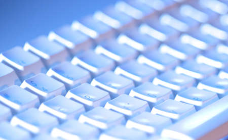 Computer keyboard close-up and back lit with limited depth of field
