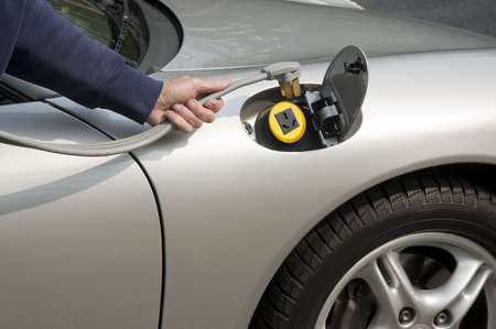 Silver electric car home refueling with a 220 volt line