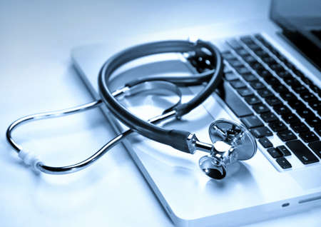 Medical stethoscope on a laptop computer, closeup