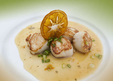 Grilled scallops in an orange sauce