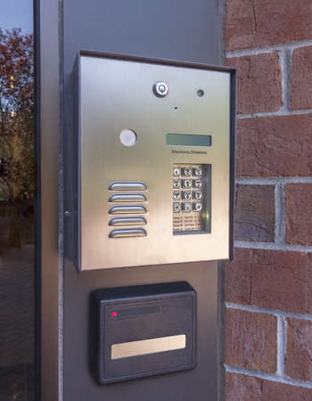 Electronic door directory and security pad near the front door entrance of a  commercial building