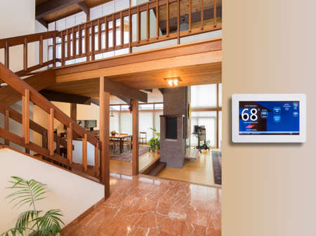 Photo for Programmable thermostat for temperature control in entrance - Royalty Free Image