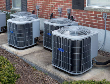 Photo pour High efficiency modern AC-heater inverter units, energy save solution-horizontal, outside an apartment complex - image libre de droit