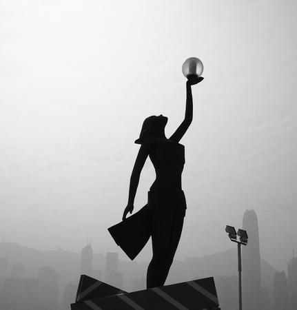 Woman silhouette raise hand