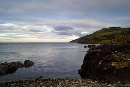 Foto de If you drive from Belfast in the direction of Giants Causeway always along the coast, comes across the Scenic Torr route and the Torr Head. The road is quite narrow, but it is rewarded with a great view. - Imagen libre de derechos