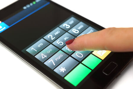 Woman is dialing on mobile touchscreen phone