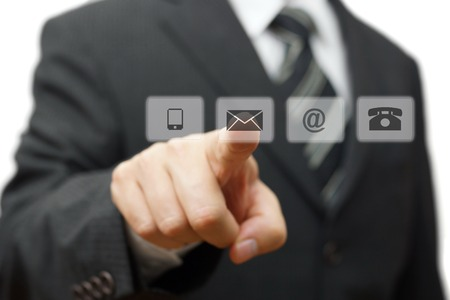 Businessman pressing virtual ( mail,phone,email ) buttons. cutomer support concept
