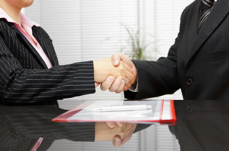 Photo for Lawyer and client are handshaking after successful meeting - Royalty Free Image