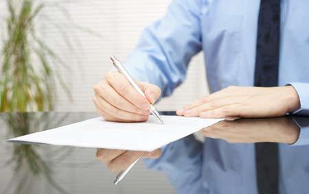 businessman is signing contract to finalize deal