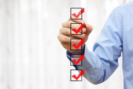 Photo pour businessman checking final  mark on checklist - image libre de droit