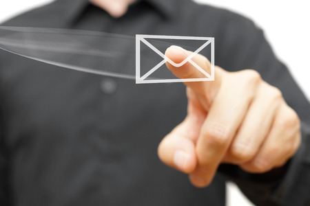 Businessman pressing flying virtual email icon