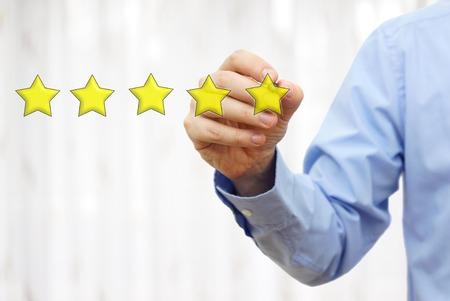 Photo pour businessman drawing five star rating,concept of quality and luxury - image libre de droit