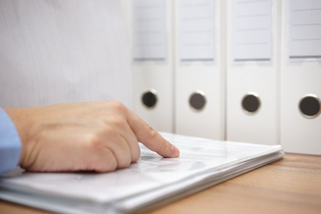 Photo pour Businessman leafing through a documentation - image libre de droit