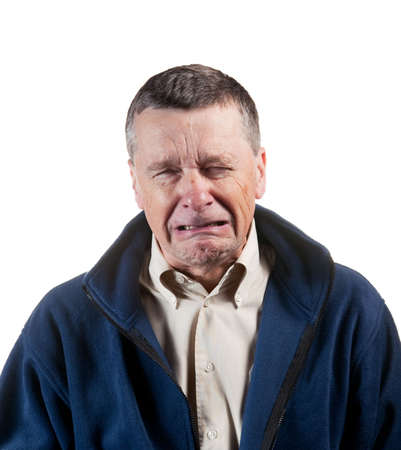 Isolated image of a middle aged man sneezing into the camera
