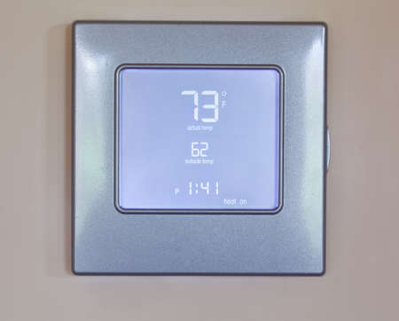 Electronic thermostat with blue LCD screen for controlling air conditioning and heating HVAC