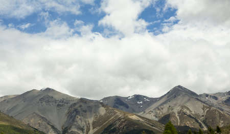 View from the train windows of TranzAlpine railway that climbs the Southern Alps in New Zealand towards Arthurs Pass