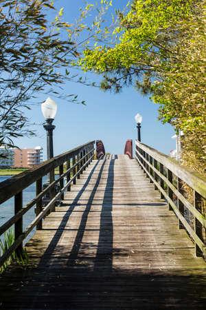 Wooden pathway across pedestrian bridge to island off Ocean City, Maryland, USA