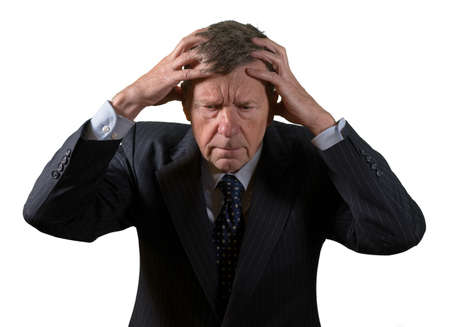 Front view and face of senior caucasian man worried and afraid with hands on head