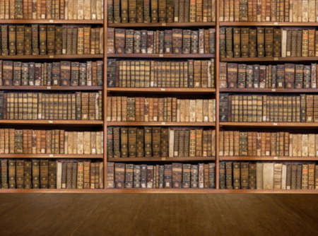 Photo pour Defocused and blurred image of old antique library books on shelves with wooden floor for use in video conferencing background - image libre de droit