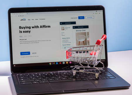 Photo pour Morgantown, WV - 2 March 2021: Shopping cart on laptop to illustrate buying using the Affirm app for Buy Now, Pay Later credit - image libre de droit