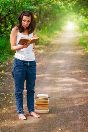 girl with books in the park