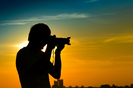 Landscape photographer in back light