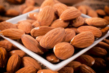 Selective focus on the raw almonds in cup
