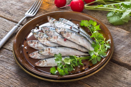 Small fishes called smelt in the plate,selective focus  on front part