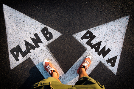 Photo for Plan A and Plan B dilemma concept with man legs from above standing on signs - Royalty Free Image