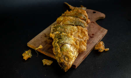 Photo for Bandeng Presto Goreng. Fried tendered-bone milkfish served with traditional side dishes - Royalty Free Image