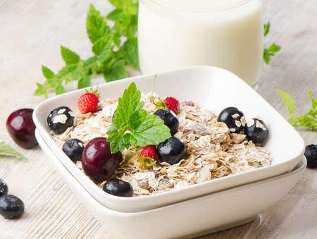 Healthy breakfast - muesli, milk and berry