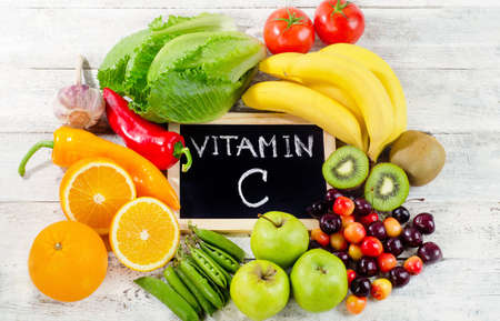 Foods High in vitamin C on a wooden board.  Healthy eating. Flat lay