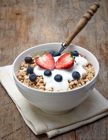Bowl of healthy muesli with yogurt and fresh berries