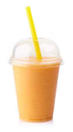 Glass of fresh mango smoothie isolated on white background