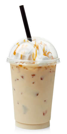 Iced caramel coffee covered with whipped cream in plastic glass isolated on white background