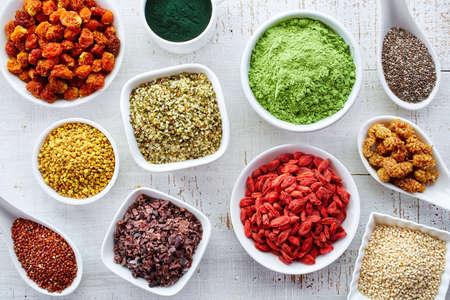 Foto für White bowls of various superfoods on white wooden  background - Lizenzfreies Bild