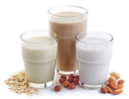 Photo pour Different vegan milk: almond milk, hazelnut milk and oat milk - image libre de droit