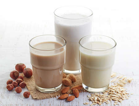 Different vegan milk: almond milk, hazelnut milk and oat milk