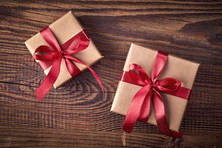 Photo for Two gift boxes on wooden background from top view - Royalty Free Image