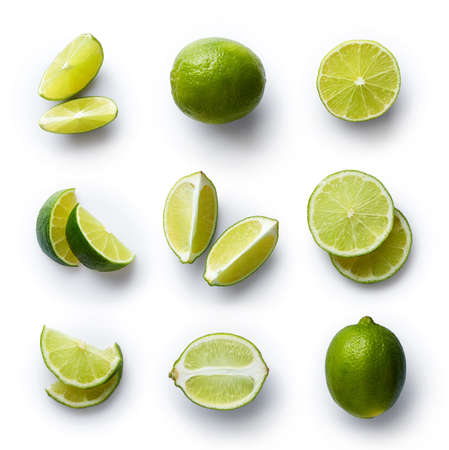 Set of fresh whole and cut lime and slices isolated on white background. From top viewの写真素材