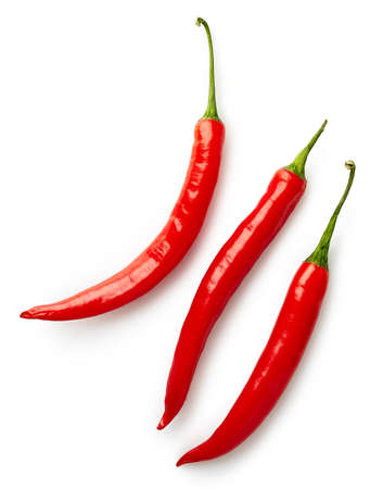 Photo for Three red hot chili peppers isolated on white background. Top view - Royalty Free Image