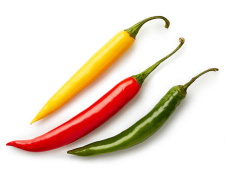 Photo for Three colorful chili peppers isolated on white background. Top view - Royalty Free Image