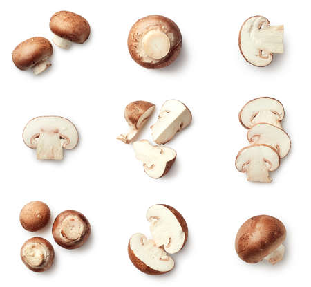 Foto de Set of fresh whole and sliced champignon mushrooms isolated on white background. Top view - Imagen libre de derechos