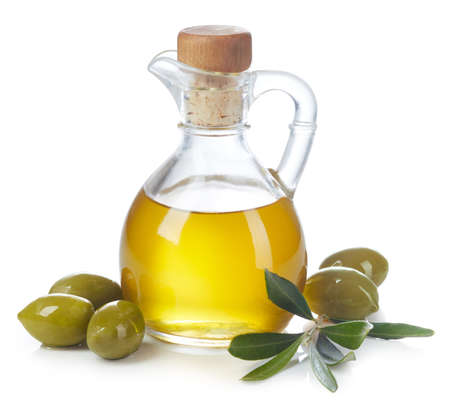 Foto de Bottle of fresh extra virgin olive oil and green olives with leaves isolated on white background - Imagen libre de derechos