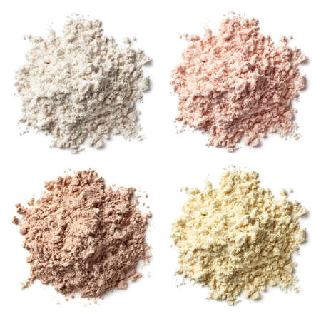 Foto de Four various heaps of protein powder (vanilla, strawberry, chocolate, banana) isolated on white background. Top view - Imagen libre de derechos