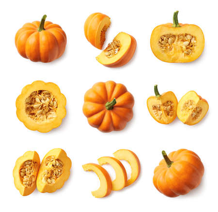 Foto de Set of fresh whole and sliced pumpkin isolated on white background. Top view - Imagen libre de derechos